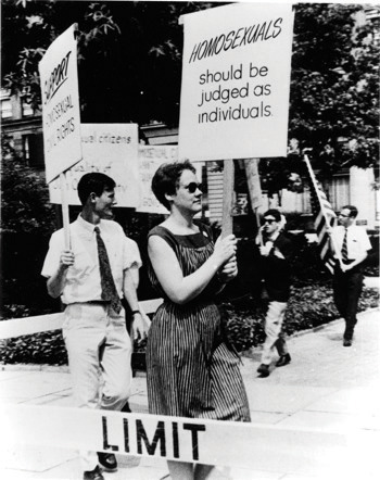 Black-and-white photo of Barbara Gittings picketing the White House in 1965