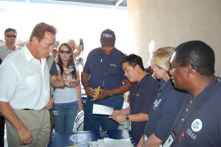 Photo of Arnold Schwarzenegger with members of FEMA.