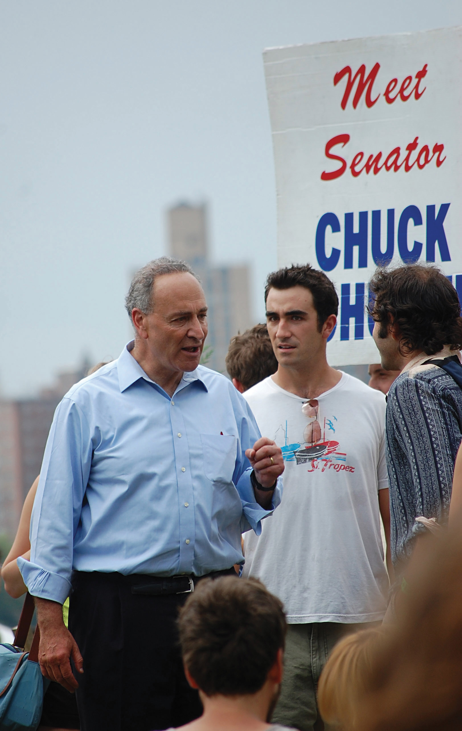 Photo of Chuck Schumer talking to supporters.