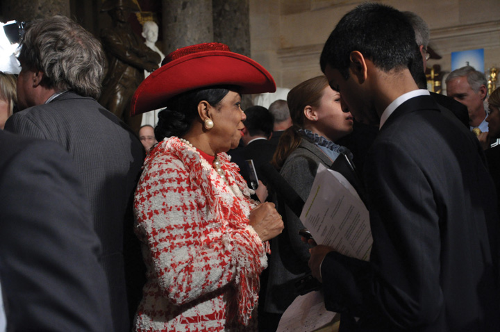 Photo of Congresswoman Frederica Wilson, wearing a red cowboy hat.