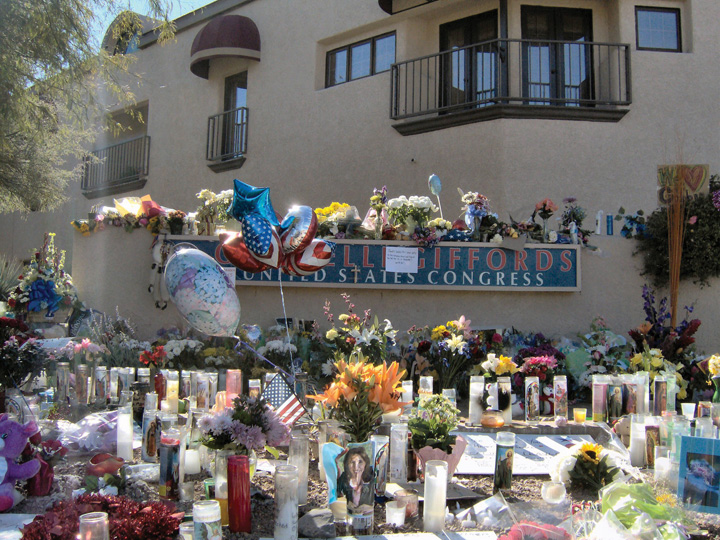 Photo of a makeshift memorial for Gabrielle Giffords outside her office in Arizona