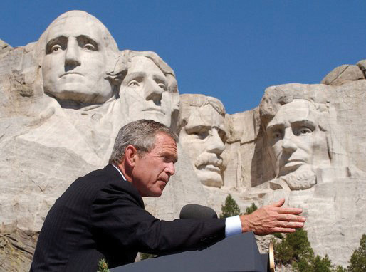 Photo of George W. Bush speaking in front of Mount Rushmore